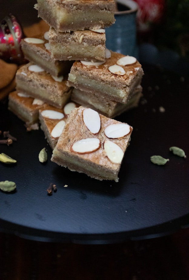 Gevulde Speculaas cookies cut into small squares.