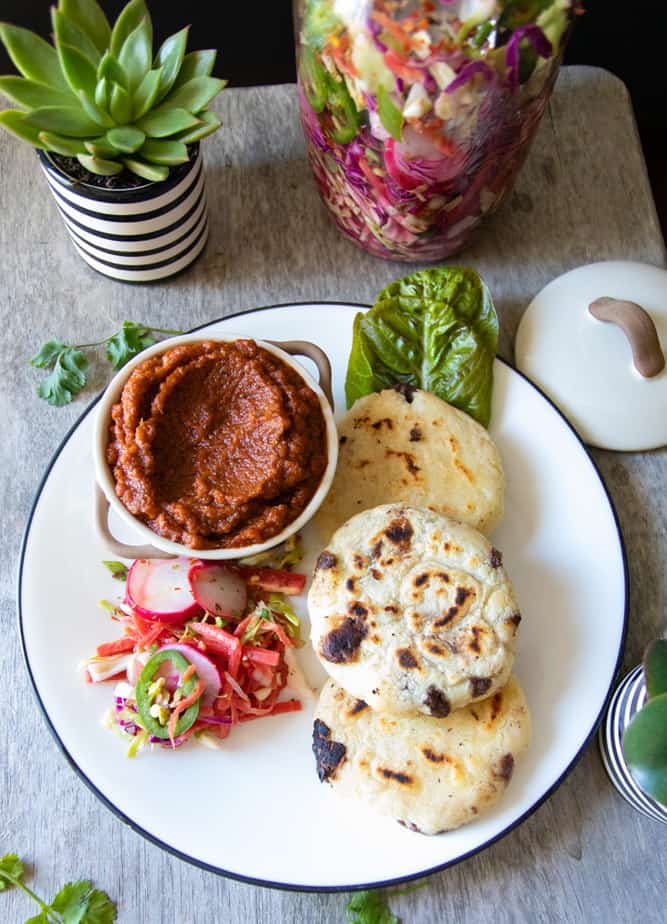 Pupusas with salsa roja and curtido
