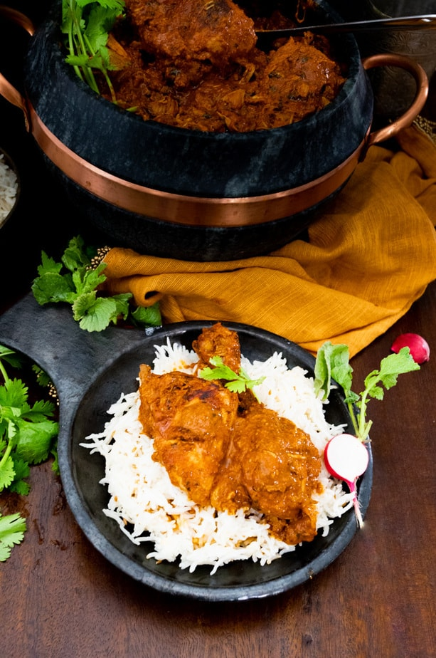 Chicken cooked in tomato sauce served on rice