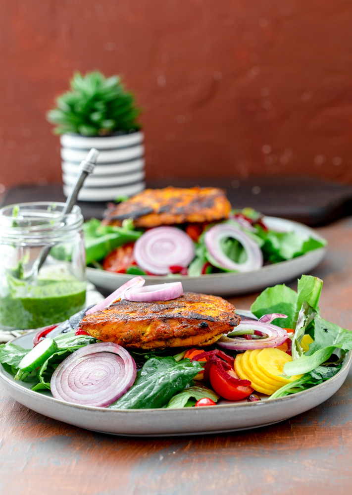 Fish in tandoori spices with a spring salad and onions