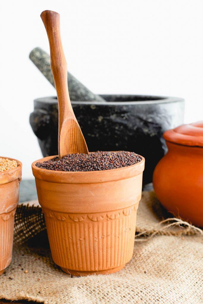 Brown mustard seeds in an earthen vase