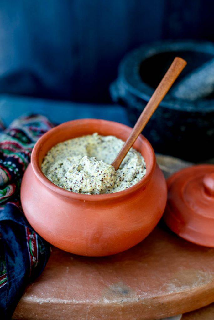 Earthen pot containing kasundi sauce