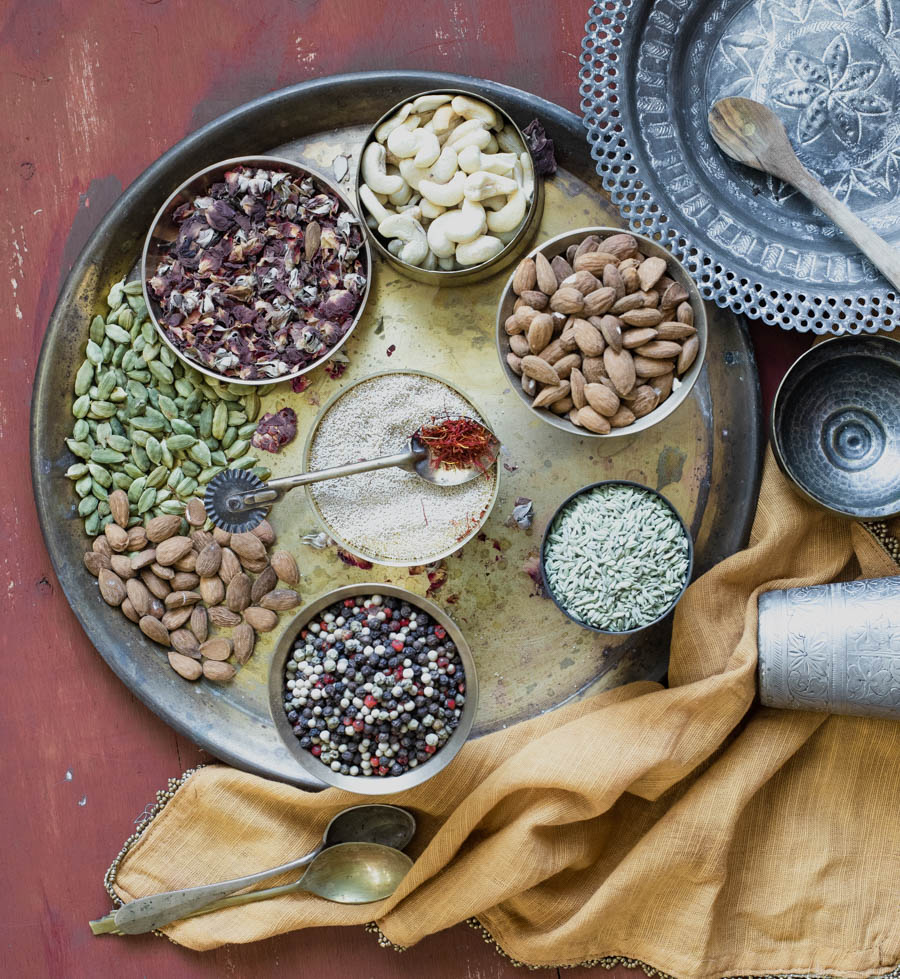 Thandai - Ingredients to make thandai - cardamom, poppy seeds, almonds and othe rnuts