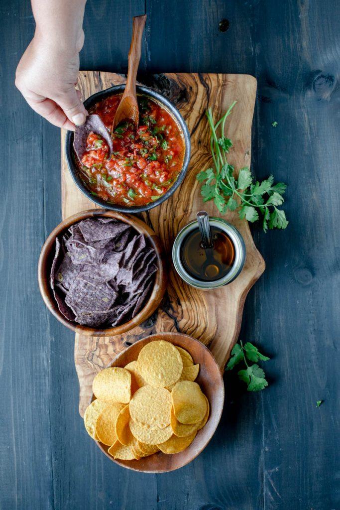 Tomato salsa, corn chips and oil